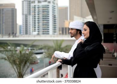 Young Emirati couple talking, Dubai, UAE