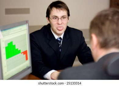 young employee putting out his tongue at his boss
