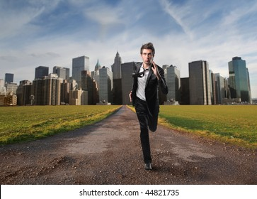 young employee running away from modern city