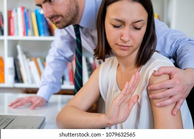 Young employee worker touched by his boss and feeling uncomfortable