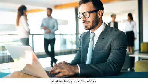 Young employee working on computer during working day in office