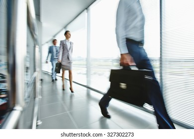 Young employees moving down office center