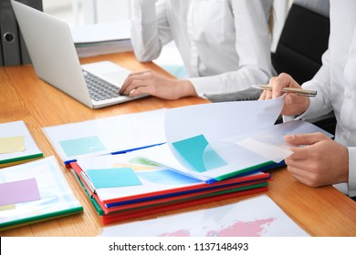 Young employees working with documents in office
