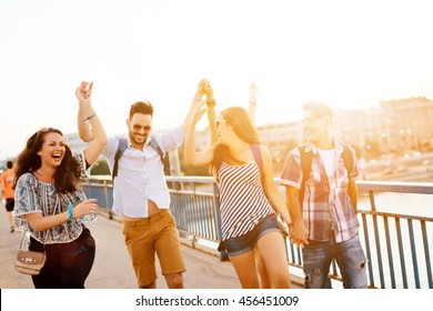 Young energetic group of people having fun in city
