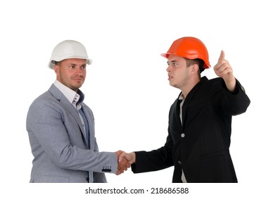 Young engineer or architect welcoming a colleague with a handshake and pointing out a direction to him, isolated on white