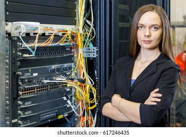 Young engineer and businesswoman at the network equipment