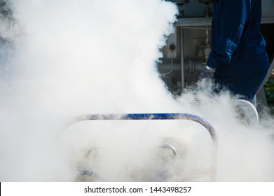 Young engineer fill with liquid nitrogen with Nitrogen storage tank at new factory
