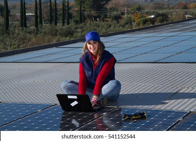 young engineer girl working on a photovoltaic plant