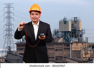 Young engineer and industrial factory