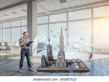 Young engineer man. Mixed media . Mixed media