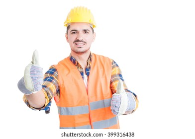 Young engineer smiling and showing thumbs up gesture with both hands acting cheerful isolated on white