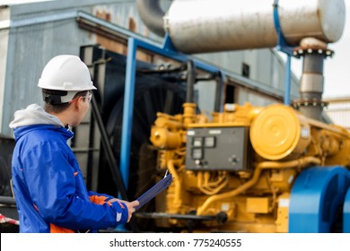 Young engineer, specialist is conducting equipment inspection on drill pump.