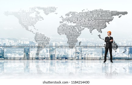 Young engineer in suit at balcony against morning cityscape background