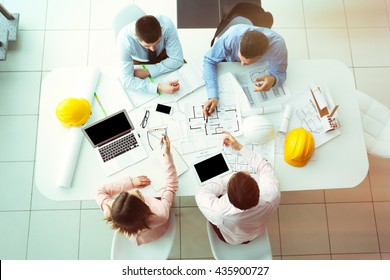 Young engineers working in the office, top view