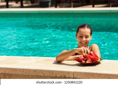Young enjoying pool and watermelon