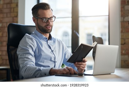 Young entrepreneur checking his schedule at work