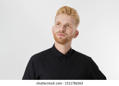 Young entrepreneur Generate Business Ideas. Close up of thinking Man in black shirt isolated with copy space. Self improvement and serious male face. Redheaded guy with red beard and stylish hairstyle