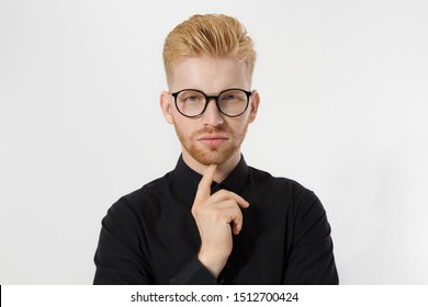 Young entrepreneur Generate Business Ideas. Close up of thinking Man in black shirt and glasses isolated, copy space. Self improvement, serious male face. Redheaded guy with red beard, hairstyle