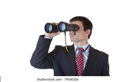 Young entrepreneur peers through binoculars and search for career.Isolated on white background.