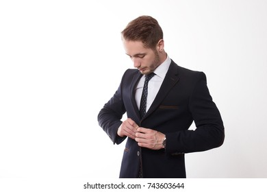 Young entrepreneur posing with suit in the studio