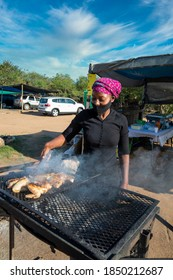 young entrepreneur , street vendor selling chicken barbeque Africa