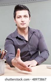 Young Entrepreneur Waiting for Handshake