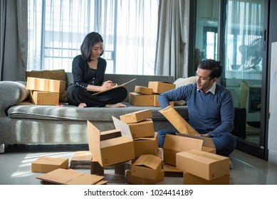 Young Entrepreneurs in Asian have just started their packaging business, online marketing and shipping and SME entrepreneurs with a business partnership working independently at home.