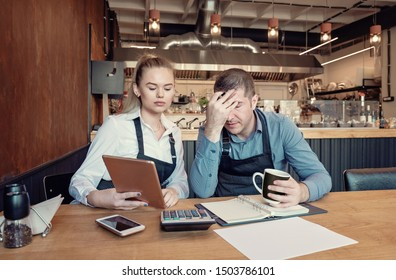 Young entrepreneurs overwhelmed by finance problems - Nervous manager checking restaurant finance - Failure in small-business concept