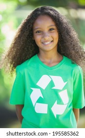 Young environmental activist smiling at the camera on a sunny day