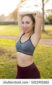 Young ethnic woman exercising outside