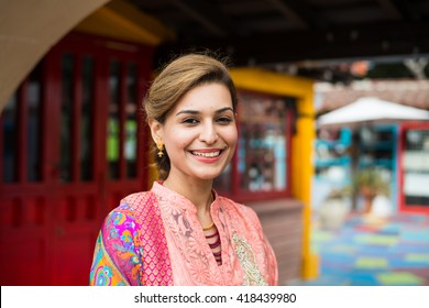 Young ethnic woman posing, colorful background