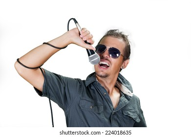 Young european rock singer wearing sunglasses on the white background