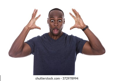young excited casual black man shocked on white background
