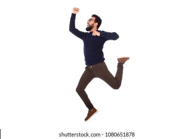 Young excited man jumping up in a side shot, isolated on a white background.