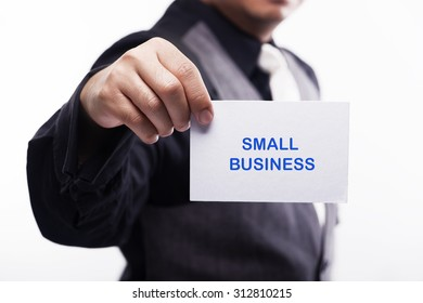 young executive holding card written small business