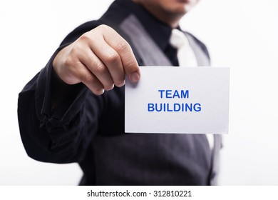 young executive holding card written team bulding