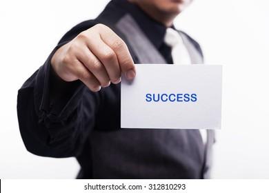 young executive holding card written success