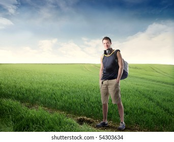 Young explorer standing on a green meadow
