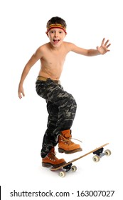 Young expressive handsome boy is skateboarding over white