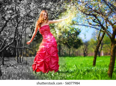 Young fairy woman in red dress painting garden.