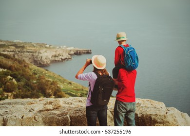 young familhy with little child hiking in scenic mountains