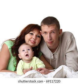 young family in bed: baby, man, woman