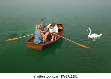 Young family in boat on lake
