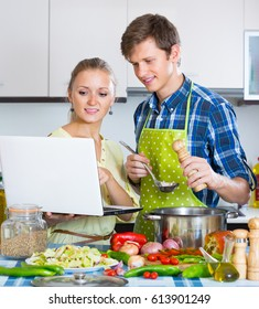 Young family browsing internet for recipe