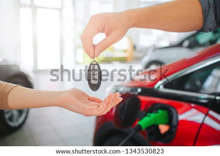 Young Family Buying First Electric Car Stock Photo (Edit Now