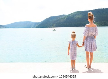 Young family by the lake. Daughter and mother together. Travel and holiday concept