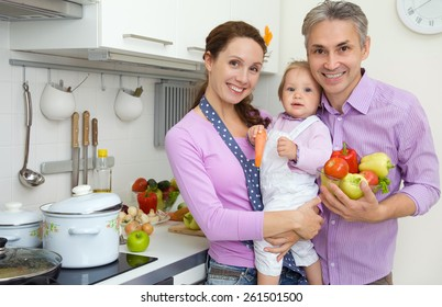 young family with a child in the kitchen at home