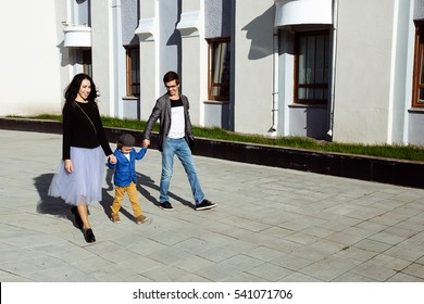 Young family with child on a walk