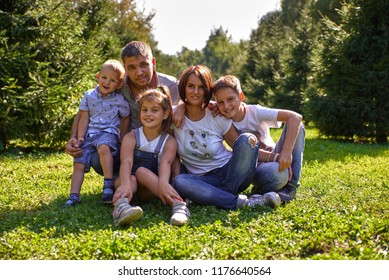 Young family with children having fun in nature.