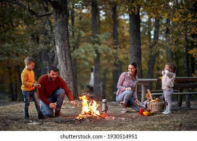 Young family with children on picnic in wood